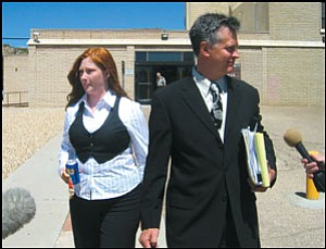 Candi Shapley and attorney Mik Jordahl leave the Mohave County Courthouse Tuesday.
