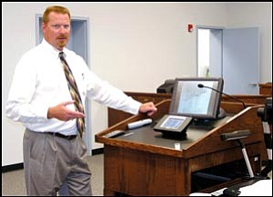"Mohave County Superior Court Division 1 Judge Charles Gurtler explains the ""electronic courtroom"" capabilities available at the new Mohave County Superior Court in Bullhead City."