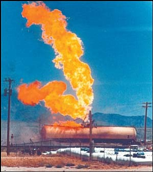 Flames shoot from a rail car full of propane prior to an explosion that killed 10 in Kingman on July 5, 1973.