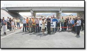 JC AMBERLYN/Miner The Airway Underpass was officially opened Friday at 11 am. Here, Mayor Les Byram and former Mayor Monica Gates cut the ribbon.