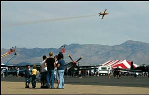 Rich Perkin's Firecat soars through the sky above the crowd at last year's Kingman Air and Auto Show. (Photo: JC AMBERLYN/Miner)