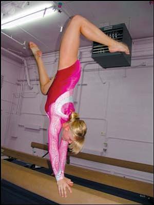 All-Starz gymnast Mariah Moon performs on the balance beam at the Cartoon Classic Invitational in Kingman on Sept. 30.