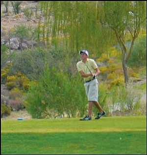 Kingman High's Tanner Theel tees off on the 18th hole at Cerbat Cliffs Golf Course during Friday's Kingman Invitational. Theel won with a 76. Photo: ROB WEILER/Miner