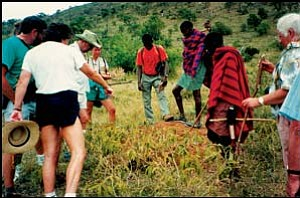 Tourists and members of the Masai Mara tribe investigate an anthill in a photo taken by Yvonne Broadribb during her 1991 trip to Kenya. Photo: Courtesy