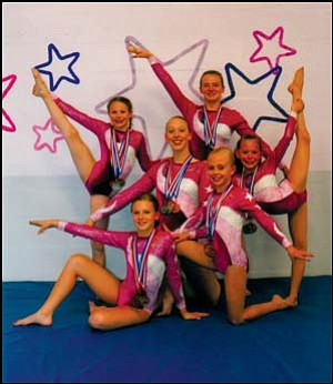 Six members of the All Starz Academy Gymnastics team in Kingman placed in the top 3 of their age divisions to win state championships in individual event and all-around competitions last month. From left to right standing in back: Sydney Tribbett, Leigh Becker, Briana Mecom.Kneeling in middle: Heather Oder and Kirsten Lewis. Front: Victoria Steighner. Photo: Courtesy