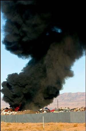 Black smoke billows from a fire at Kingman Auto Recycling Wednesday afternoon. Photo: JC AMBERLYN/Miner