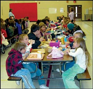 Lunch is a time to eat and socialize with friends in the gymnasium at Manzanita Elementary School. Photo: TERRY ORGAN/Miner