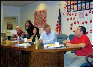 Kingman Unified School District Governing Board members converse Tuesday night during a short recess at their monthly meeting. From left are Bill Goodale, Terri McMullen, Margaret McBee, Pat Carlin Jr. and Charles Lucero. Photo: TERRY ORGAN/Miner