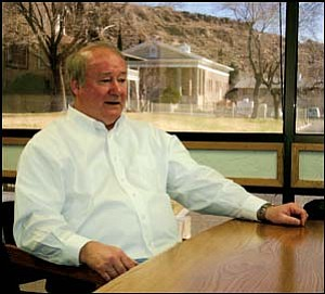 Kingman City Manager Paul Beecher sits inside his office Wednesday morning with Miner reporter Nick Wilbur to discuss growth in Kingman and the prospects of Kingman Crossing. JC AMBERLYN/Miner