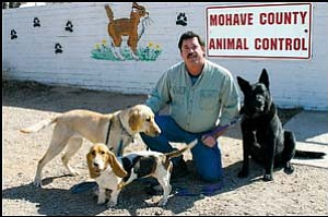 Roy Hayes, CARE-Net founding member, animal trainer and behaviorist, urges the public to participate in a petition campaign to support improved sheltering and adoption of companion animals in Mohave County. He is shown with Kimber, Alkey and Jake (a once starving, rescued dog who completed therapy dog training with its highest designation for complex situations). JC AMBERLYN/Miner