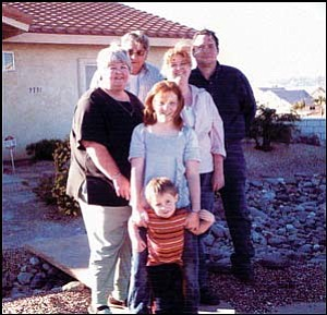 Tammy Towry's family is pictured Thanksgiving of 2005. Adults from left are Judy Perry (her mother), Sam Perry (her father), Tammy, Roger Towry Jr. (husband). Children in front are Destiny Perry and Aidan Towry. Courtesy