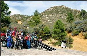 The county recently finished a new ATV trail in Hualapai Mountain Park that these riders just finished taking a ride on  Saturday.  A grand opening ceremony will be held at 2 p.m. on Monday to officially open the trail. JC AMBERLYN/ Miner