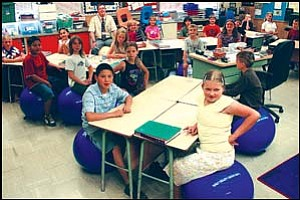 Brock Odegard's third-grade class at Manzanita Elementary School is making use of stability balls, instead of standard chairs at desks. Some of the advantages include improved posture, exercise and stretching. J.C. AMBERLYN/Miner