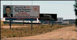Billboards line Route 66 in Kingman. NICHOLAS WILBUR/ Miner