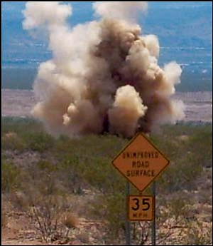 The Kingman Police Department bomb squad detonates dynamite sticks found in an abandoned vehicle in Golden Valley Wednesday morning. Justin Mayberry/Courtesy