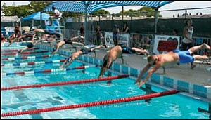 Swimmers dive in for the start of the 9-10 boys 50-meter freestyle event at the 3rd Annual Dick Tomlin Memorial Invitational swim at Centennial Pool July 14. Included in the photo are Kingman Dolphins' Tyler Julle in Lane 2 (second from right) and Jacob Miyauchi in Lane 3. JC AMBERLYN/Miner
