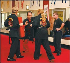 Ted Guerrero (center) demonstsrates punching techniques to his students at the Moore's Shou Shu Martial Arts studio in downtown Kingman. JC AMBERLYN/Miner