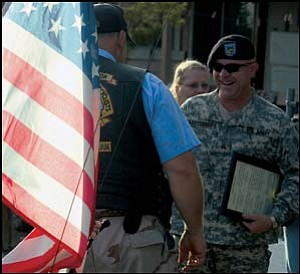 Iraq veteran Sergeant Manny Arredondo is shown Aug. 4 greeting people, including Kingman Patriots, who escorted him to the American Legion Hall downtown as part of a homecoming celebration.  JC AMBERLYN/Miner