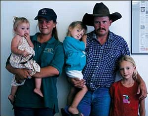 The entire family is preparing for Joshua Appleby's participation in the first ever Extreme Mustang Makeover Challenge, sponsored by the Mustang Heritage Foundation. Pictured are (left to right) Clara (1), Cecilia (Josh's wife), Kiley (3), Joshua and Leah (8) Appleby. Not pictured but also part of the family is 6-year-old Arianna. JC AMBERLYN/Miner
