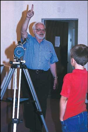 Dan Lordahl, past president of the High Desert Astronomy Club, speaks with students at Emmanuel Christian Academy Thursday.  JC AMBERLYN/Miner