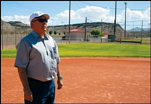 Fermin Esquibel looks out Thursday morning over the Little League field his father, Frank, helped create. Frank Esquibel passed away July 17 after giving 32 years of his life to the children who played on these fields.  JC AMBERLYN/Miner