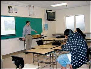 Social Studies teacher Kevin Voit instructs a small class in early Chinese civilization at Music Mountain Junior/Senior High School. TERRY ORGAN/Miner