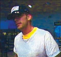 KPD/Courtesy This is a surveillance picture of the suspect in an armed robbery of a Wells Fargo Bank in Flagstaff on Sept. 28.  The Kingman Police Department believes this is the same suspect from the armed robbery of Chase bank on Tuesday in Kingman.