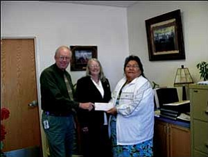 Receiving a check for $280,000 are Steve Condict, Superintendent PSUSD, and Business Manager Vickie Logan from Hualapai Tribal Co-chair Sherry Counts.  Courtesy