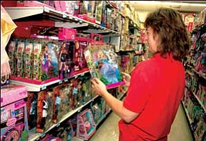 Tanya Charon looks at a Barbie Island Princess doll Wednesday at Big Kmart. Larger crowds of toy shoppers are expected now that the holiday season has shifted into high gear.  JC AMBERLYN/Miner