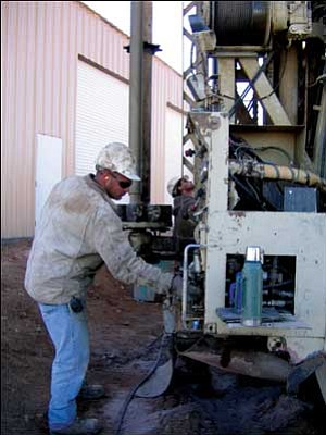 Brown Drilling employee Theo Siaperas drills a well for Pinion Pine Fire Department's Station No. 2, 6095 Fire Grounds Road. The well and its pump were donated by Brown Drilling and A-1 Well Service.  AMANDA KAUFMAN/Courtesy