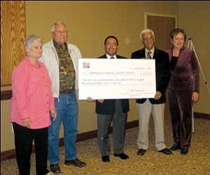 Local officials were on hand to accept a $26 million check from the Arizona State Lottery. From the left is County Recorder Joan McCall, Supervisor Tom Sockwell, Arizona Lottery Executive Director Art Macias, Bullhead Mayor Jack Hakim and Kingman City Councilwoman Janet Watson.   SUZANNE ADAMS/ Miner