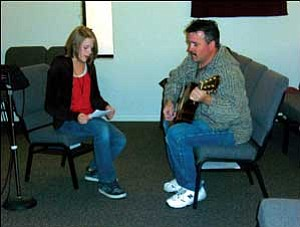 "Alyssa Dunham rehearses ""Gloria in Excelsis Deo,"" with Tom Bacoka on guitar, at Manzanita Baptist Church Monday. Dunham organized a Christmas concert featuring local singers and musicians, which will be given Friday at Kingman Christian Church. ANDRAYA WHITNEY/Miner"