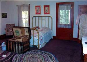 The upstairs bedroom of one of George Bonelli's daughters is large and includes two doors to the porches that surround the house on three sides. The Bonelli children would often sleep on the porches to keep cool on summer nights. ANDRAYA WHITNEY/Miner