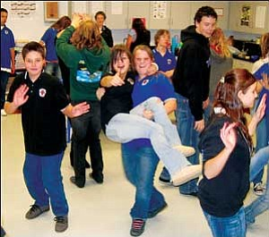 KAOL High School students participate in salsa dancing before tasting various salsa recipes Tuesday afternoon during the school's 3rd Annual Salsa Contest. From left to right in the foreground, facing the camera, are Dakota Cazares, Gina Diaz and Janece Glennon.  JC AMBERLYN/Miner
