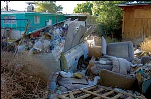 It took the Mohave County Environmental Health Department more than a year and a court order to get the trash and other debris removed from this property on North McVicar. Courtesy