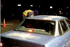 Mohave County Sheriff's Deputy Ryan Bridges stops a motorist during the sobriety checkpoint in the 2300 block of Northern Avenue on Dec. 21. Courtesy/MCSO