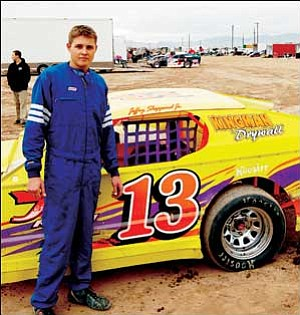 Jeffrey Sheppard Jr. stands next to the No. 13 Kingman Drywall car after placing second in the first heat of the IMCA Modified Division race at Mohave Valley Raceway on Saturday. The 2005-06 champion finished in fifth place in the main event. SHAWN BYRNE/Miner