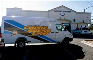 The Kingman Police Department's Crime Scene Unit was at Downey Savings and Loan, 3240 Stockton Hill Road, on Thursday collecting evidence following an armed robbery. ANDRAYA WHITNEY/Miner
