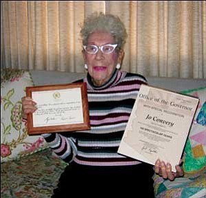 """TERRY ORGAN/Miner Jo Convery holds birthday greetings conveyed to her by President and Mrs. George Bush, left, and Arizona Gov. Janet Napolitano. """"How they got my age I don't know,"""" Convery said."""