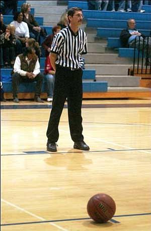 Chuck Casson refs a basketball game Feb. 12 at Kingman High. JC AMBERLYN/Miner