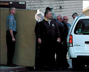 Warren Jeffs is escorted into the Mohave County Courthouse Wednesday morning under heavy security.  JC AMBERLYN/Miner