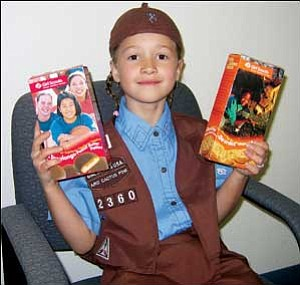 Kaylee Morley shows boxes of peanut buttered flavored cookies that were among 542 boxes she sold as a member of Girl Scouts Arizona Cactus-Pine Council Troop 2360 in her first year of eligibility to sell them. TERRY ORGAN/Miner