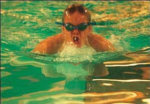 Patrick Webb is pictured at the Kingman Dolphins swim Wednesday night at Del Webb Fitness Center.  Last weekend, Webb qualified for 11 events at the state meet. JC AMBERLYN/Miner