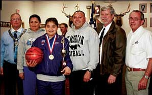 Desirae Gonzalez earned recognition Wednesday night at the Elks Lodge in Kingman for winning the grasping the title of Regional Elks Hoop Shoot Champion for girls ages 10 to 11. From left to right is Elks Exalted Ruler Elect Donald Radley; Desirae's mother, Melissa; Desirae; her father, Danny; local Lodge Chairman Jim Acer and Jerry Grimes, past state president of the Arizona Elks. JC AMBERLYN/Miner