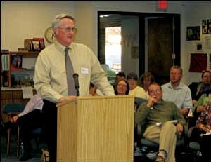 Mike Kearns, chancellor of Mohave Community College, addresses the Kingman Unified School District Governing Board on Tuesday night. He spoke about donating college land to the district upon which a new high school would be built.  TERRY ORGAN/Miner