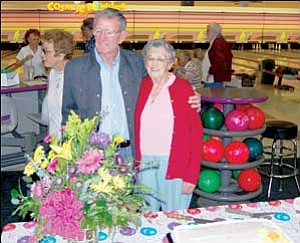 Jack and Girlie Stanton stand with her 95th birthday cake and bouquet of flowers that were given to her Thursday.  SHAWN BYRNE/Miner