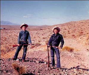 """Bob """"Boze"""" Bell, left, and childhood friend Daniel Harshberger stand outside the ghost town of White Hills in 1959.  Courtesy"""