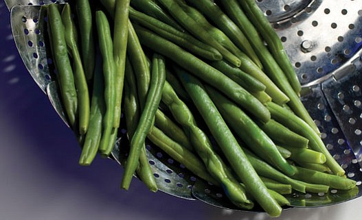 Ross Hailey/Fort Worth<br> Star-Telegram, MCT<br><br.  Steaming green beans using a metal steaming basket can keep nutrients in.