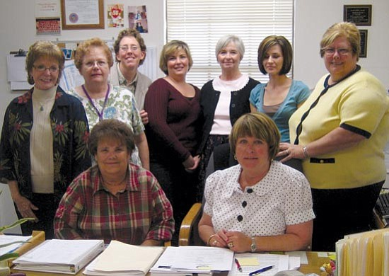 SUZANNE ADAMS/ Miner<br><br><br/>The Mohave County Attorney's Office Victim/Witness Program offers a helping hand to victims through a number of programs. Pictured standing from left to right are Victim's Advocate Coordinator Betty Munyon, Eileen Matta, Restitution Advocate Brenda Truesdell, Julie Emard, Claims Investigator Judith Johnsen, Domestic Violence Councilor Karen Gracely and Domestic Violence Coordinator Pat Pirkle. Seated in front from the left are Director Rhonda Chastain and Assistant Director Kathy Cancik.