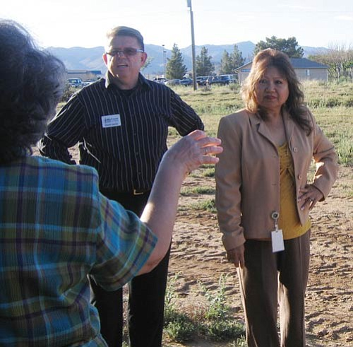 TERRY ORGAN/Miner<br><br> Chuck Spotts, vice chancellor of instruction and student services at Mohave Community College, takes a question Monday from Rosanne Rosenberg, arm extended, secretary of the Kingman Center for Performing Arts Committee, about property the college is donating for the center. Lynne Steiger, committee chairwoman, is standing next to Spotts.
